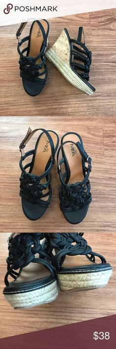 """Mia Black Platform Wedges 8.5 Cork Strappy Mia Girl 8.5 Strappy Black Wedge Sandals Rope & Cork   Beautiful Black and Tan footbed with Cork and jute Platform Wedge. Size 8.5M. Rubber sold for grip and traction. Silver ankle strap hardware. Approximate measurements: 1"""" platform height, 5"""" wedge height. See photos for signs of wear. Smoke/pet free home.  Mia Woven Black Platform Wedge Sandals 8.5 Women's Mia Shoes Wedges"""