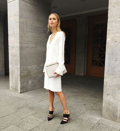 Dress from Envii by Pernille Teisbaek, Clutch from Loewe, Mules from Gianvito Rossi