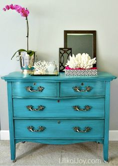 The pop of blue on this DIY painted Craigslist dresser looks so chic with the coral accessories www.settingforfour.com