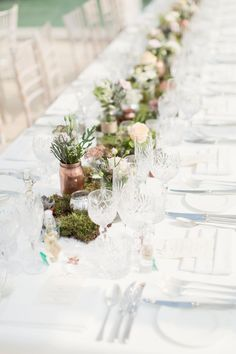 Moss table runner with candles & spray painted copper jars full of flower stems -