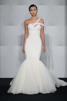 Not a fan of this style of dress, but I love the bodice and shoulder. The fabric is great as well. (Mark Zunino)