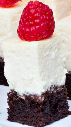 Brownie Cheesecake Bites ~ made with a fudge brownie crust, topped with a creamy cheese cake layer... Two wonderful desserts in one delicious bite!