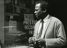 Miles Davis' style was always very thought out, there were no accidents -- every detail said something about him, and was there for a reason. It's easy to look at this picture and miss the subtle, but very telling, details.