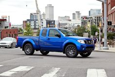 Keep on truckin' with Nissan Frontier PRO-4X -- 261-hp, 4.0-liter V-6.   Nissan, Truck, Pickup, Blue, Nissan Frontier, 4x4, decals, sporty, small truck