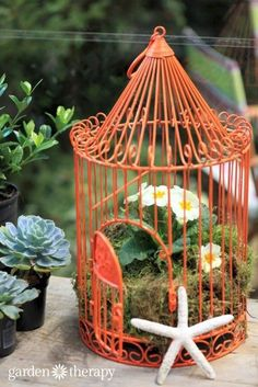 Birdcage planter instructions plus more birdcage projects to add some decorative flare hanging from a tree or as an outdoor table centerpiece. Add just one or two to your backyard or make plenty of them for wedding decor. #birdcages #ad #garden