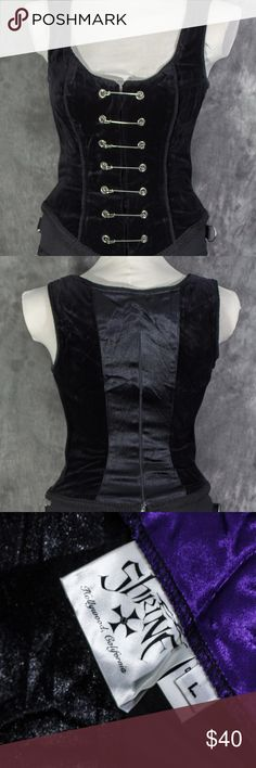 """Vintage Shrine Gothic Goth Kilt Pin Corset Top Made in Los Angeles' by Shrine Clothing. Made near the end of the golden Gothera this beautiful velvet top was one of the most popular pieces made during that time.  Shrine used only the highest quality fabrics with great attention to the details. 2"""" vanity panel in front. Lots of decorative rope trim and 1/2"""" gimp braid trim around the entire bottom.  Zipper on the back zips from the top down . 2 power stretch panels in back help hourglass you…"""