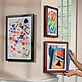 to store and display kiddos art... love this. each kid gets their own frame. can easily add the most recent work of art and display it proudly without cluttering up the entire house!