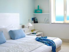 Mediterranean style bedroom in white with serenity blue accents