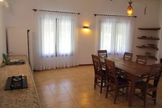 Casa Inge has a small kitchen and a very nice dining room for our guests. The house is bright because of many windows. Surrounded by nature and close to the beautiful sandy beach the holiday home offers a lot of privacy and a beautiful view!!