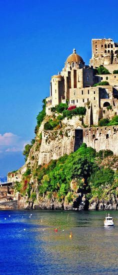 The Aragonese Castle, a medieval castle at the northern end of the Gulf of Naples, Italy. It stands on a volcanic rocky islet that connects to the larger island of Ischia by a causeway.