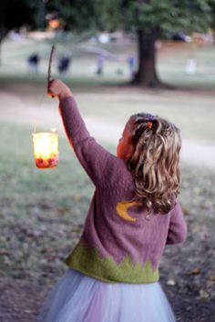 Children's lantern walk.  I love this idea and think it would also be a fun thing to do in March when it's still cold and dark but the excitement of the holidays is over and yet Spring seems a million miles away.