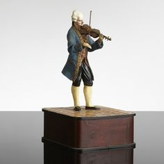AUTOMAT with SPELDOSA, the fourth quarter of the 19th century, probably France, in the form of violinist dressed in the 17th century suit, manual playpen, the two arms of the figure, biscuit, papier maché, paper, textile and wood, contemporary wooden box included, height 27.5 Playpen, Old Dolls, Automata, 17th Century, Wooden Boxes, Biscuit, Manual, Two By Two, Arms