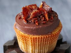 Mmm gotta try - Maple cupcakes topped with creamy milk chocolate ganache get a perfect hit of smoky salt and pepper when topped with crumbled candied bacon. The butch bakery