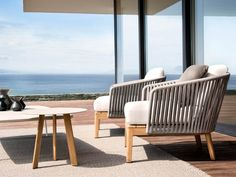 The airy design of the Mood club chair and its warm combination of teak and…