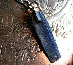 Genuine Raw Blue Kyanite with attached Black Tourmaline Pendant on sterling silver chain necklace    $54.90 USD Handmade item Materials: sterling silver, tourmaline, kyanite Made to order Feedback: 5 reviews Ships worldwide from California, United States I HAVE A LARGE SELECTION TO CHOOSE FROM!