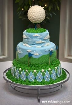 Golf cake. Two layers. Blue, gold, white, pastel green. Argyle pattern on bottom layer. top layer with flags. Keep the tee and golf ball.  Chocolate cake. Maybe Swiss or German chocolate.