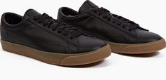 Nike Black Tennis Classic Ac SP Sneakers The Nike Tennis Classic AC SP for AW15, seen here in black. - As part of the brands US Open Pack, these pared-back sneakers from Nike are crafted from premium leather with a comfortable vulcanised gum http://www.comparestoreprices.co.uk/january-2017-6/nike-black-tennis-classic-ac-sp-sneakers.asp