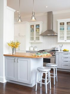 White Kitchen | Herringbone Pattern | Mosaic Tile | Backsplash Ideas