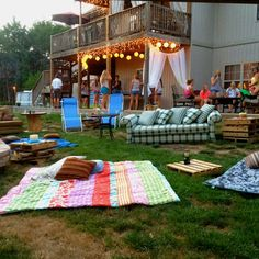 outdoor movie night ideas.  Icicle lights from the deck, crates for tables.