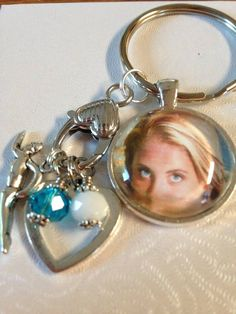 Check out this item in my Etsy shop https://www.etsy.com/listing/247305943/personalized-photo-key-chains-we-can