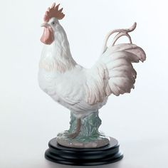 Lladro Porcelain Figurine The Rooster Lladro http://www.amazon.com/dp/B005AGSZ8S/ref=cm_sw_r_pi_dp_ZcBkvb1VEVDAX