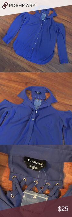 NEW Bebe Cold Shoulder Top All in 1 style top! Collar, open shoulder, buttons down! This is dark blue in color. NWT! bebe Tops Button Down Shirts