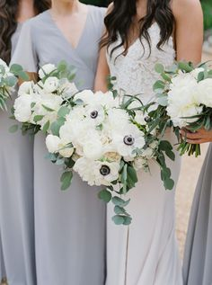 Show me your mumu bridesmaids dresses, garden flower bouquets, white greenery and blue color palette. Barnsley Garden wedding planned by We Tie The Knots.