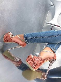 | Python Platform Spike Heelz watch on your own risk