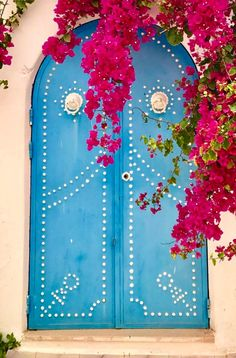 Djerba, Tunisia. Blue painted Door in Tunisia.  Learn more at Instagram.com - Wendy Schultz - Portals.
