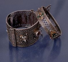 Two Berber Silver Bracelets, Morocco  Decorative metalwork and inlaid precious jewels on two Berber bracelets from a Moroccan museum.