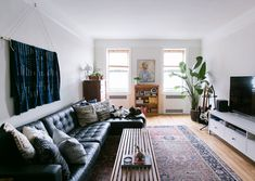 Natural Light Floods Into The Couple's Living Room Tour On Design*Sponge