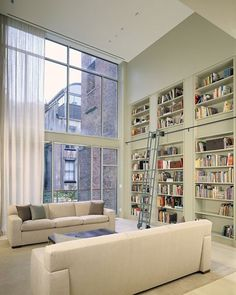 Double height space with full height sheer curtains by Deborah Berke, Remodelista