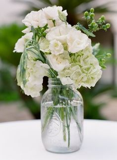 Green and ivory flowers in a mason jar (Photo by La Dolce Vita Photography)