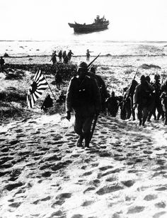Earlier in 1939, Imperial Japanese army and naval units continued to attack and push forward into China and Mongolia. Here Japanese soldiers advance inland over the beach after landing at Swatow (Shantou), one of the remaining South China coast ports still under Chinese control at that time, on July 10, 1939.