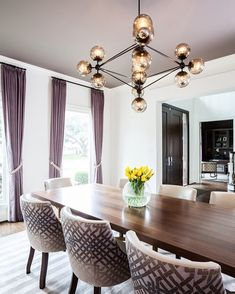 Ok so how dramatic is this dining room by @laurauinteriordesign? Im not a huge fan of purple but she makes it look GOOD. And I love the how that modern chandelier is thrown in there to keep it from looking too stuffy. Good move. And whats even better? We found it for less.  http://ift.tt/2mhZbV7 #CopyCatChic