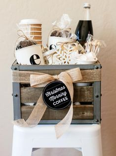coffee gift basket. cups, coffee beans, stir sticks, cold brew coffee, syrup, chocolate covered coffee beans