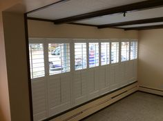 Custom composite shutter from Norman Window Fashions, installed by Budget Blinds of Livonia