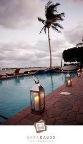 Lanterns in black or white around the pool...and floating flowers would.be cool