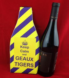 Wine Koozie, Keep Calm and GEAUX TIGERS by WhatsInANameCustomAr on Etsy The other side says:  I enjoy a glass of wine each night for its health benefits.  The other glasses are for my witty comebacks and flawless dance moves.