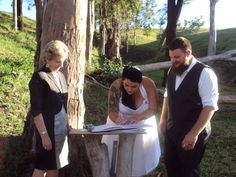 Signing the register on a specially crafted table made from recycled timber. A country wedding, complete with cows and pond. In a lovely secluded glade. #myweddingblog