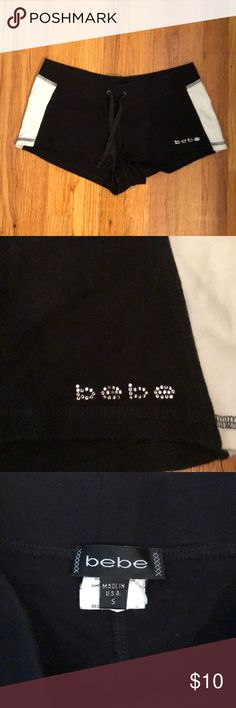 Black Bebe Drawstring Booty Shorts Super cute black & white cotton shorts from Bebe (with silver Bebe in corner with rhinestones). Cute for either athletic events or just for Pj & lounging ! In perfect condition- elastic waist with drawstring also bebe Shorts