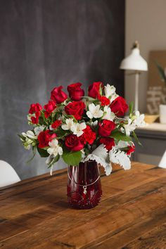 Teleflora's Red Haute Bouquet in a red glass lantern | Valentine's Day Flowers | Gifts | Romantic Gifts | Red Roses | #teleflora #flowers