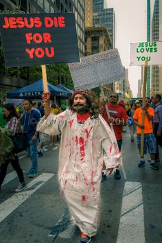 HELTER SKELTER (He's coming for you) - Composition Wednesday #PhotoOfTheDay #SMYNYC #jesus #manson #preacher #bloody #HelterSkelter #NYC #NewYork #streetphotography #NikonPhotography #Photography #Nikon #ErikMcGregor #2016   © Erik McGregor - erikrivas@hotmail.com - 917-225-8963