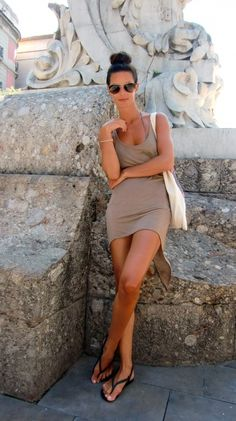 Neutral tank dress, flip flops, bikini, bun, and sunglasses...looks like the perfect vacation wear :)