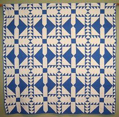 "Vintage blue and white quilt, circa 1920-1930. The design is a very graphic one, related to ""Wild Goose Chase"" but probably original."