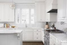Classical French White Kitchen  Statuary marble La Cornue chrome finish