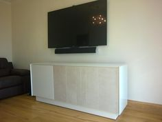 Book S02 a 3 door sideboard with glass surround. Doors are in white gloss glass and Luna ceramic colour. Delivered to our client in London.