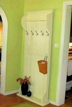 Repurposed door with coat hooks