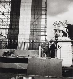 Structure (Florence Henri, 1937) // In preparation of the yearly Bastille Day celebration, Swiss born photographer Florence Henri documented men working on a scaffolding to install a banner of the French flag at the entrance of the Tuileries gardens in Paris in 1937. On the right and in the background the equestrian sculpture Fame mounted on Pegasus by Antoine Coysevox as well as other statues are visible in the gardens of the Louvre palace.
