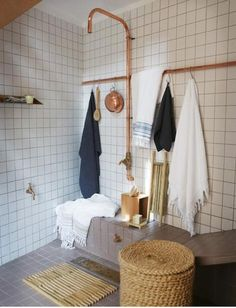 Copper piping, not to mention the white tiles, give a classic early 20th Century feel to this bathroom.